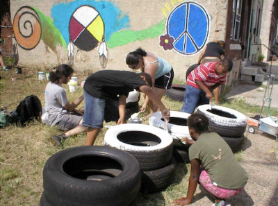 Volunteers decorating tires