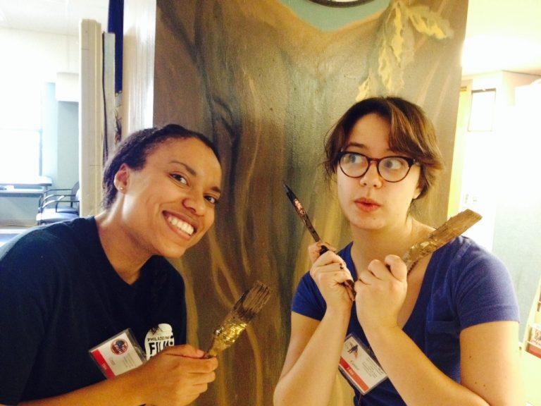 ASI volunteers painting