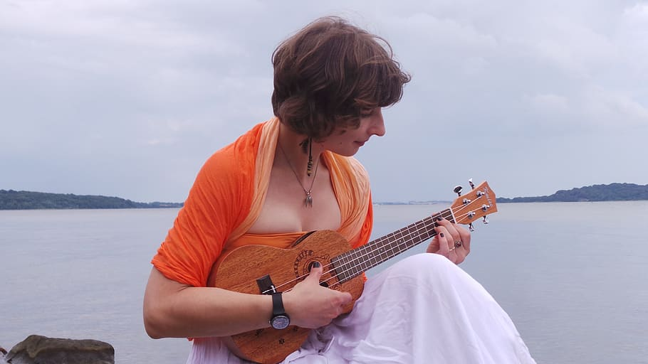 young-woman-playing-the-ukulele-music-instrument-acoustic-hobby